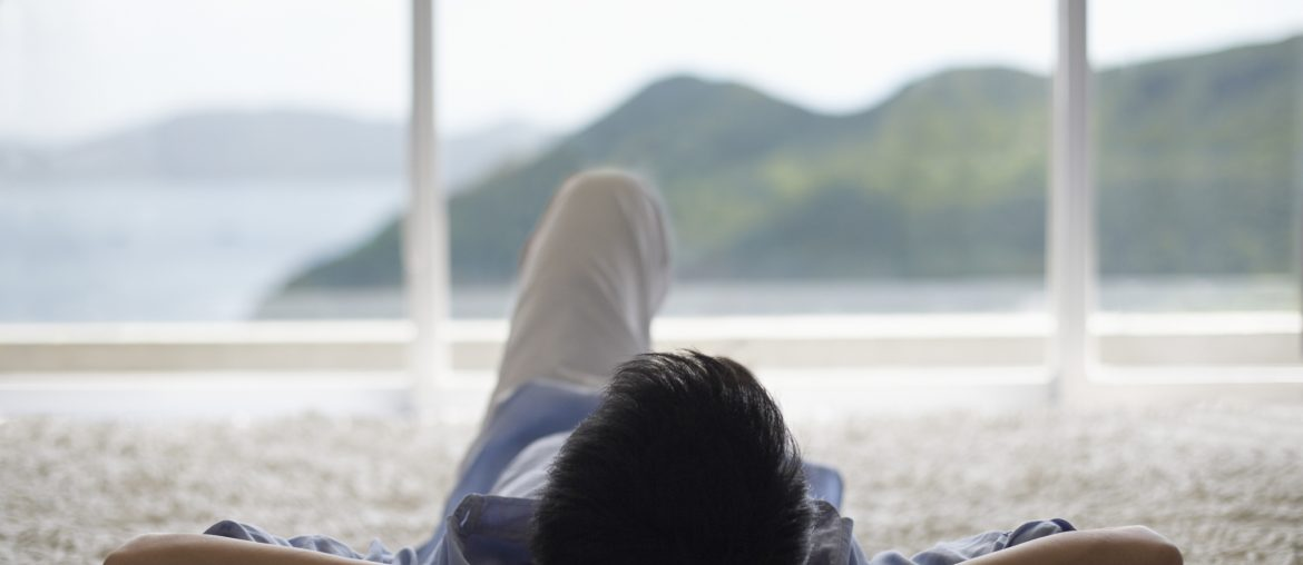 Man Lying Down and Looking Out of Picture Window